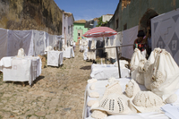 Crocheted and embroidered linens for sale on an old cobbled street in Trinidad, Cuba, West Indies, Central America