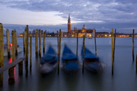 Gondolas at dusk and San Giorgio di Maggiore in the background, Venice, UNESCO World Heritage Site, Veneto, Italy, Europe