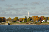 An old village with a church steeple along the St. Lawrence River in Quebec Province, Canada, North America