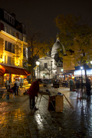 The Sacre Coeur and Montmartre on a rainy night, Paris, France, Europe
