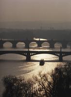 A boat passes under one of the bridges over the Vltava River in Prague, Czech Republic, Europe
