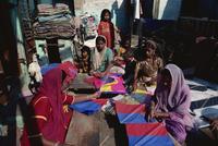 Muslim women making vast quantities of tissue paper kites for January kite festival, Ahmedabad, Gujarat, India, Asia 20062005255| 写真素材・ストックフォト・画像・イラスト素材|アマナイメージズ