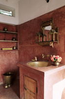 Pink finished plaster walls and hand beaten brass bathroom sink, residential home, Amber, near Jaipur, Rajasthan state, India, A