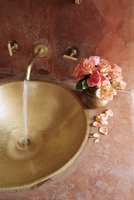 Detail of brass hand beaten bathroom sink in bathroom area of a residence, Amber, near Jaipur, Rajasthan state, India, Asia