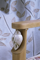 Detail of the arm of a drawing room chair in new build home, New Delhi, India, Asia