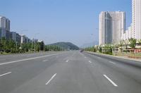 Blocks of flats beside road to Nampo, ten lanes wide but no traffic, Pyongyang, North Korea, Asia