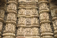 Some of the 646 erotic figures carved in sandstone on exterior of the Kandariya Mahadeva Temple, largest of the Chandela temples