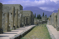Restored buildings in Roman town buried in AD 79 by ash flows from Mount Vesuvius, in the background, Pompeii, UNESCO World Heri