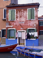 A typical canalside house, with washing line, in Burano, Venice, Veneto, Italy, Europe