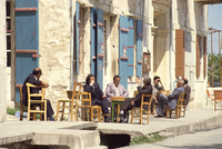 Men sitting outside on the pavement, putting the world to rights, one Sunday morning in Lefkara, Cyprus, Europe