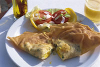 A bric, deep fried turnover, with salad in Tunisia, North Africa, Africa