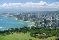 View over coast north west from lookout on crater rim of Diamond Head, over Kapiolani Park and city of Waikiki, Oahu, Hawaii, Un