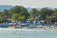 Outrigger fishing boats at the town beach of this major south coast resort, Pangandaran, West Java, Java, Indonesia, Southeast A