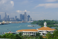 Ferry terminal of popular island resort with Keppel Harbour and the city in the background, Sentosa Island, Singapore