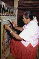 Navajo Indian woman weaving on a vertical loom, New Mexico, United States of America, North America