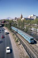 The Metro train alongside a road in Santiago, Chile, South America