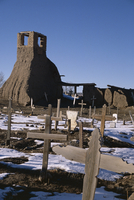 Snow on the ground in February in the old churchyard which was destroyed in the 1847 revolt when 150 Indians died, Taos Pueblo,