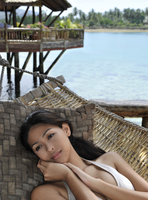 Girl on hammock, Pearl Farm Resort on Samar Island in Davao, Mindanao, Philippines, Southeast Asia, Asia 20062010771| 写真素材・ストックフォト・画像・イラスト素材|アマナイメージズ