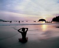 Girl doing yoga on Kata Beach, Puket, Thailand, Southeast Asia, Asia