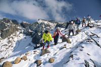 A group of hikers descending on Mount Furanodake in the autumn, on the island of Hokkaido, Japan, Asia