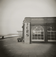 Image taken with a Holga medium format 120 film toy camera of ices sign on side of old Rendezvous Cafe on dull winter's day, Whi