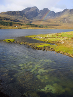 View across the clear waters of Loch Slapin to rainbow over the Cuillin Hills, the peak of Bla Bheinn (Blaven) prominent, near T 20062019214| 写真素材・ストックフォト・画像・イラスト素材|アマナイメージズ