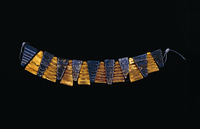Necklace of triangular beads of gold and lapis-lazuli.