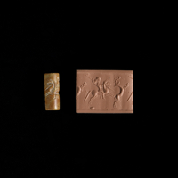 Cylinder seal of streaked red and pale brown siliceous limes