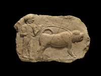 Baked clay plaque showing in low relief a male mastiff or eq