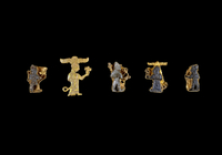 Most of the thirty-eight small gold figures (five illustrate