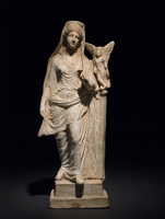 Terracotta group: Aphrodite and Eros.  Aphrodite standing, h