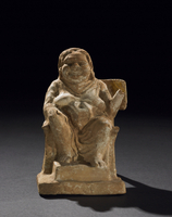 Terracotta figure of extremely overweight woman sitting on a