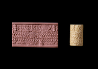 Cream ivory or bone cylinder seal; in the upper right sits a