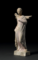 Terracotta figure of a boy, his right hand by his side, his