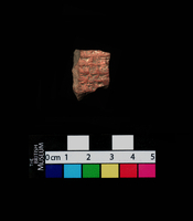 Fragment of a clay cylinder, 4 lines of inscription.