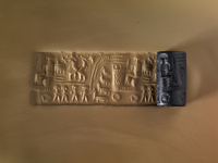 Black hematite cylinder seal; a charioteer is seated in a fo