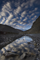 Reflection of clouds in water next to the Kali Ghandaki rive