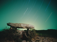 Long exposure of stars above a rock bridge in the Eastern Py
