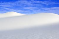 White sand dunes against blue sky, White Sands National Monu