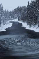 Whirlpool with pieces of ice in water, Kitkajoki River, Kuus
