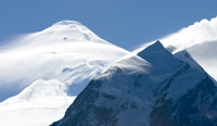 Mount Cook / Aoraki covered in snow with fine clouds, New Ze