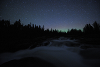 Starlit sky, and Northern lights, over White Water, river, S