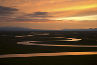 Sunset over winding river in Bayinbuluke Swan Lake Nature Re