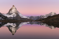 Matterhorn at sunrise in autumn with reflection in the Riffe