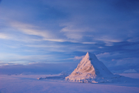 Pyramid of sea ice catching the first rays of the returning