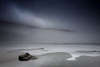 View of frozen Llynnau Mymbyr, a mountain lake, with fog par
