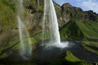 Seljalandsfoss waterfall, with rainbow in smaller stream of water, Iceland, June 2008