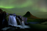 Small waterfall near Mount Kirkjufell with aurora borealis in the night sky, Snaefellsnes, Iceland, September 2010