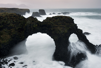 Coastal rocks including an arch in winter storm, Arnarstapi, Snaefellsnes peninsula, Iceland, January 2011