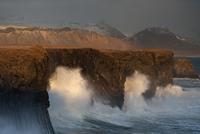 Waves breaking on cliffs on a windy day, Arnarstapi, Snaefellsnes Peninsula, Iceland, February 2011